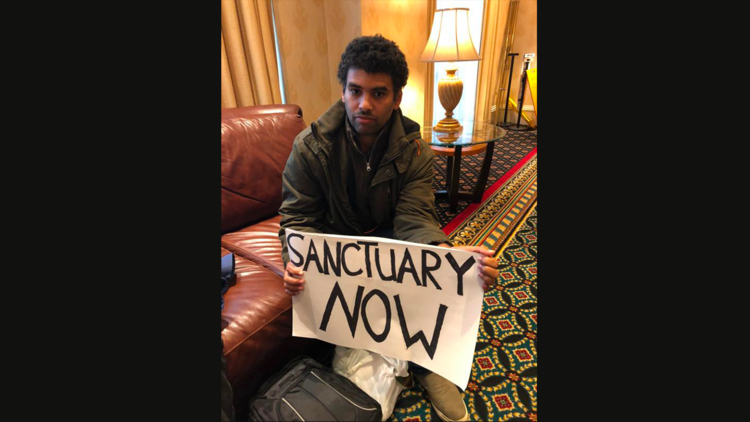 Sanctuary-city activist Felix Cepeda of New York City is seen during the first day of the U.S. bishops' fall general assembly in Baltimore on Nov. 13. He planned to pray and fast for the next three days in hopes the Catholic Church would offer its church properties as places of sanctuary to keep families intact if a family member faces deportation. (CNS photo/Rhina Guidos)