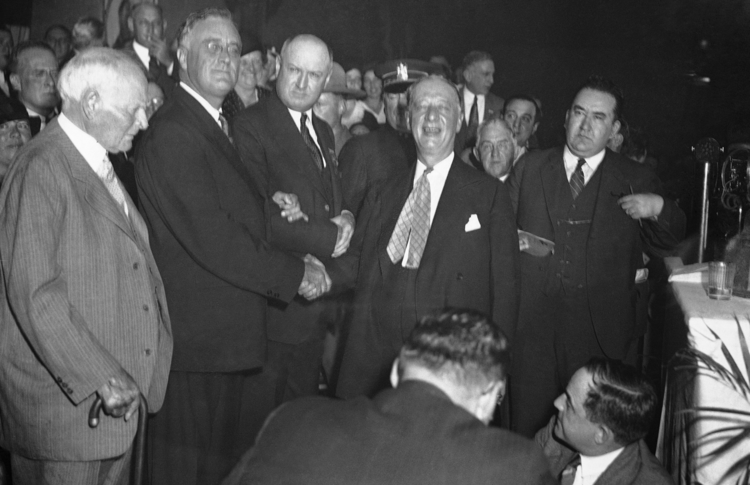 After a fierce battle for the presidential nomination in June 1932, Al Smith shakes hands with Gov. Franklin D. Roosevelt at the state Democratic convention in Albany, N.Y., Oct. 4, 1932. (AP photo)