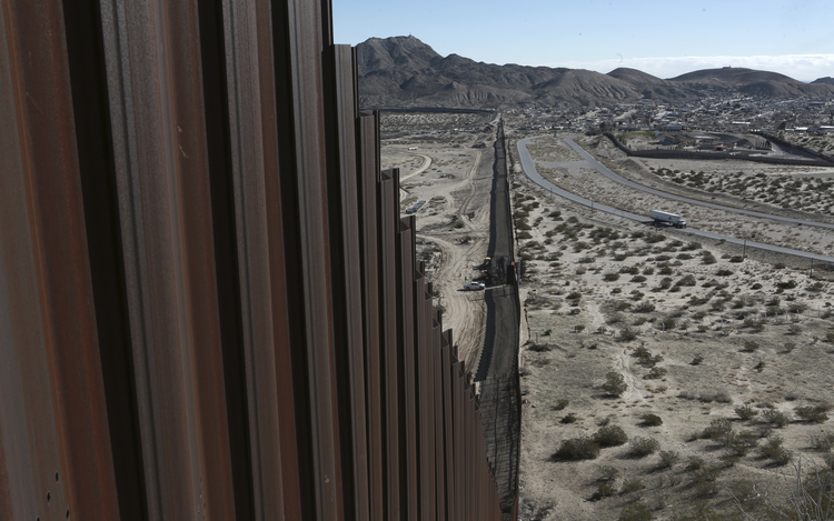 This Jan. 25, 2017, file photo shows a truck driving near the Mexico-US border fence, on the Mexican side, separating the towns of Anapra, Mexico and Sunland Park, New Mexico.  (AP Photo/Christian Torres, File)