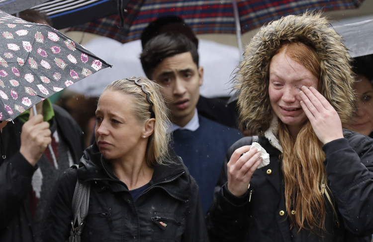 Londoners participate in a moment of silence on Tuesday morning to remember terrorist attack victims in the London Bridge area. (AP Photo/Matt Dunham)