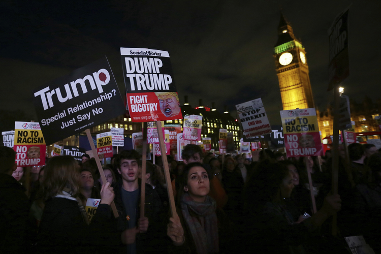 Demonstrators on Feb. 20, 2017, rally in Parliament Square against a planned state visit by U.S. President Donald Trump. (AP Photo/Tim Ireland)