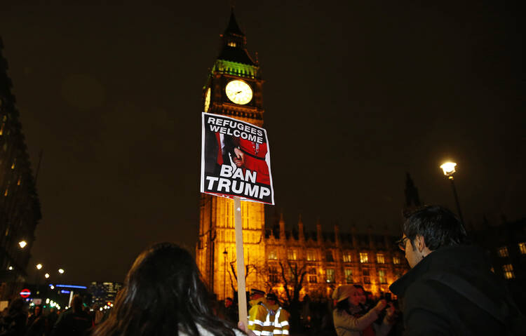 Demonstrators protest against U.S. President Donald Trump's controversial travel ban on refugees and people from seven mainly-Muslim countries, in London on Jan. 30. (AP Photo/Alastair Grant)