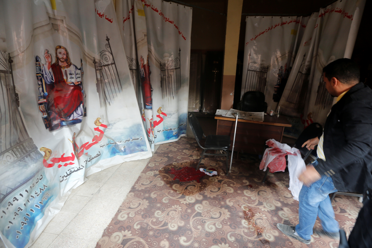 Blood stains are seen Dec. 29 on the floor of the Coptic Orthodox Church of Mar Mina in Helwan, Egypt, near Cairo (CNS photo/Amr Abdallah Dalsh, Reuters).