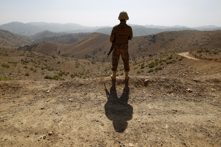 A soldier in North Waziristan, Pakistan, stands guard along the border fence with Afghanistan, Oct. 18 (CNS photo/Caren Firouz, Reuters).