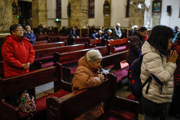People pray during morning Mass Jan. 30 in the Cathedral of the Immaculate Conception in Beijing. (CNS photo/Roman Pilipey, EPA)