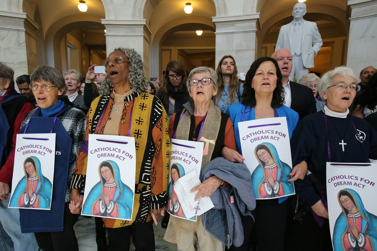 "Sisters of Mercy and others pray inside the Russell Senate Office Building in Washington Feb. 27 during a ""Catholic Day of Action for Dreamers"" protest (CNS photo/Bob Roller)."