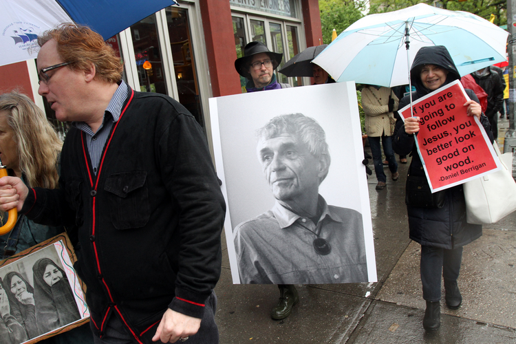 Mourners participate in a peace march May 6 prior to the funeral Mass of Jesuit Father Daniel Berrigan in New York City, May 6, 2016 (CNS photo/Gregory A. Shemitz).