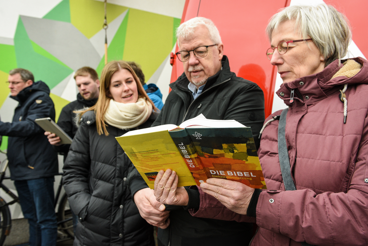Demonstrators stand outside the German bishops' spring meeting in Lingen, March 11. The sexual abuse scandal and demands for reform have changed the German church, Cardinal Reinhard Marx of Munich said March 14. (CNS photo/Harald Oppitz, KNA)