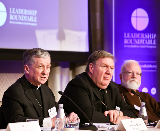 Chicago Cardinal Blase J. Cupich, left, speaks during a Feb. 1, 2019, panel discussion at the Leadership Roundtable's Catholic Partnership Summit in Washington to put forth possible solutions to the church's sex abuse crisis.  (CNS photo/Ralph Alswang, courtesy Leadership Roundtable)