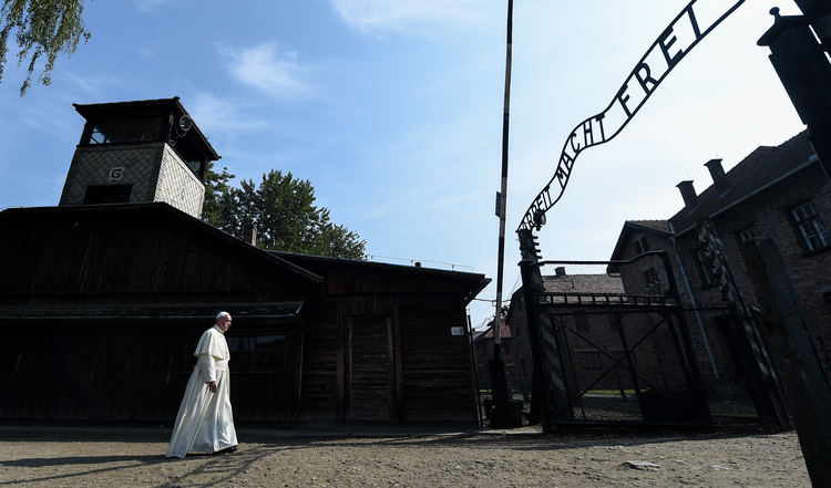 Pope Francis enters the main gate of the Auschwitz Nazi death camp in Oswiecim, Poland, July 29, 2016 (CNS photo/Alessia Giuliani, pool).
