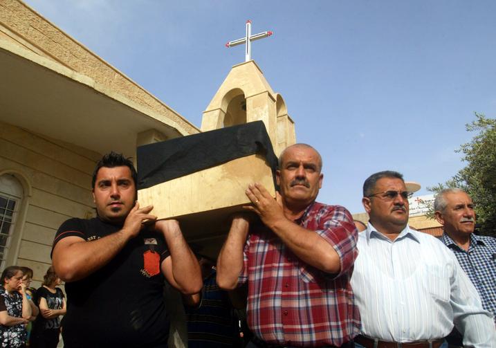 Iraqi men carry the coffin of a Christian man, who was killed by unknown gunmen, during his funeral in 2011 in Kirkuk (CNS photo/Khalil Al-A'nei, EPA).