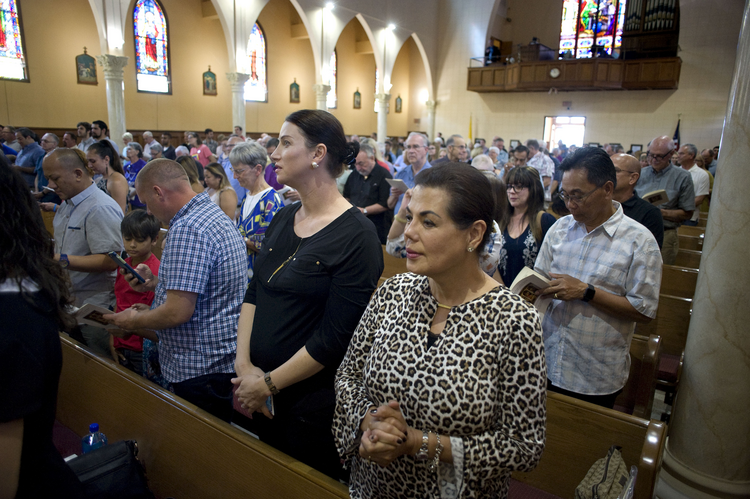 People pray during Mass Oct. 7 at St. John the Evangelist Church in San Diego (CNS photo/David Maung).