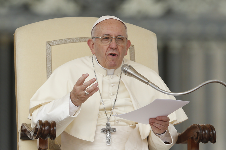 Pope Francis speaks during his general audience in St. Peter's Square at the Vatican on April 18. (CNS/Paul Haring)