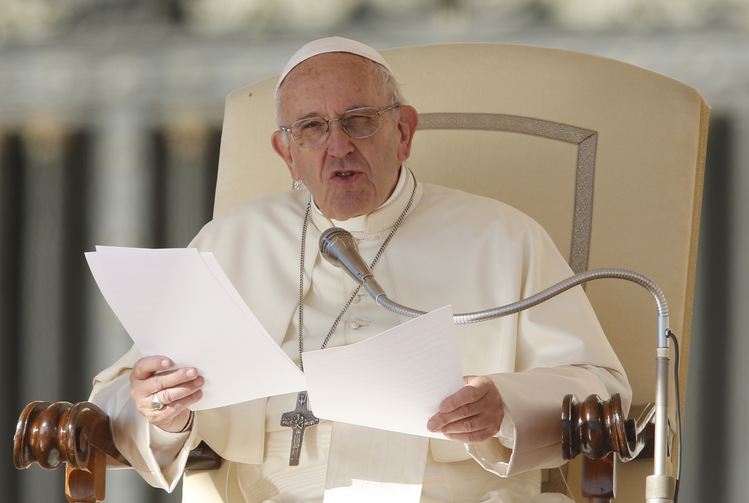 Pope Francis speaks during his general audience in St. Peter's Square at the Vatican Oct. 11. (CNS photo/Paul Haring)