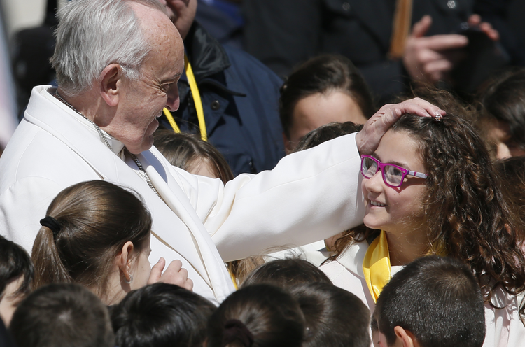 04.19.2017 Pope Francis greets a young choir member during his general audience in St. Peter's Square at the Vatican April 19. (CNS photo/Paul Haring)