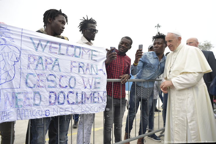 "Pope Francis greets people at the ""Regional Hub,"" a government-run processing center for migrants, refugees and asylum seekers, in Bologna, Italy, Oct. 1. (CNS photo/L'Osservatore Romano)"