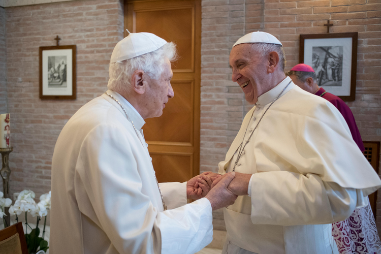 Pope Francis greets Pope Emeritus Benedict XVI during a visit with new cardinals at the retired pope's residence, Nov. 19, 2016 (CNS photo/L'Osservatore Romano, handout).