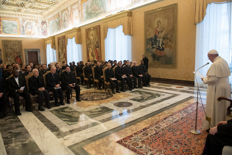 Pope Francis leads an audience with faculty and staff of the Jesuits' International College of the Gesu at the Vatican Dec. 3. (CNS photo/Vatican Media)
