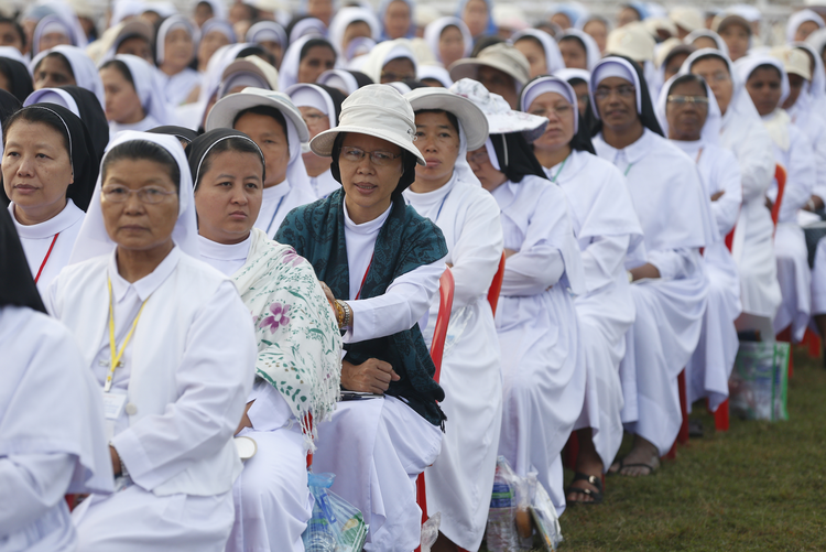 Nuns wait for the start of Pope Francis' celebration of Mass at Kyaikkasan sports ground in Yangon, Myanmar, Nov. 29. (CNS photo/Paul Haring)