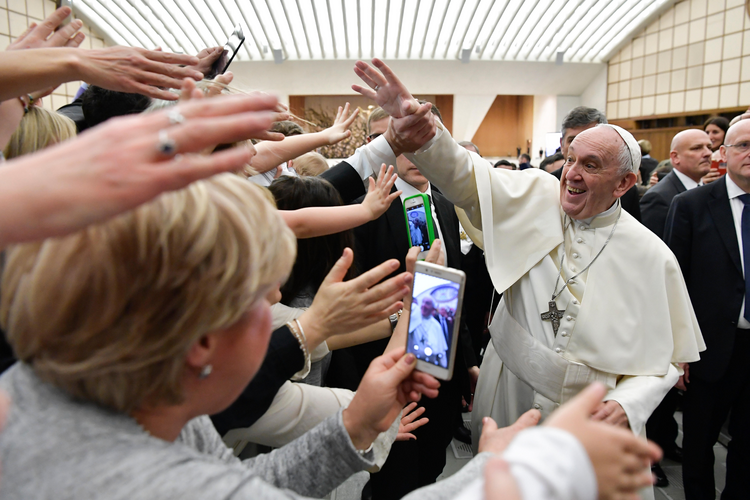 03.05.2018 Pope Francis greets people during an audience with Italian nurses in Paul VI hall at the Vatican March 3. (CNS photo/Vatican Media)