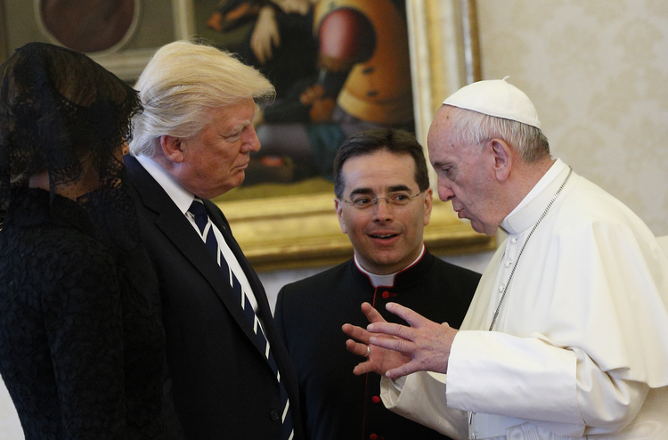Pope Francis talks with U.S. President Donald Trump during a private audience at the Vatican May 24 (CNS photo/Paul Haring).