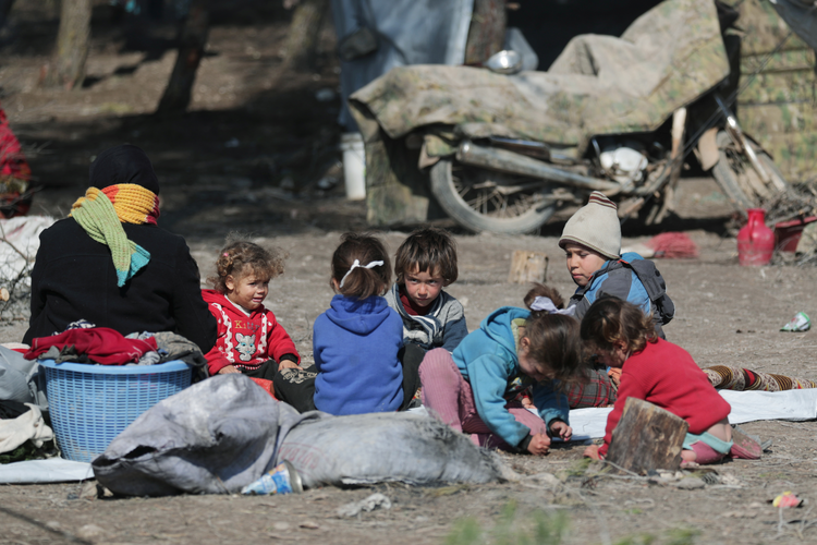 Syrian children sit on the ground at a makeshift camp in Qatmah Feb. 17, 2020. The Sept. 27 celebration of World Day of Migrants and Refugees will emphasize people displaced within their own countries. (CNS photo/Khalil Ashawi, Reuters)