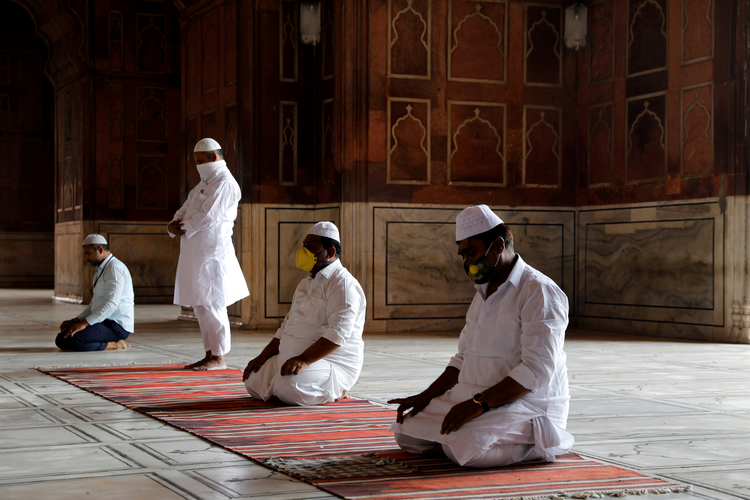 Image:  Muslim men wearing masks offer prayers at a mosque on the first Friday of Ramadan, May 1, during the coronavirus pandemic in New Delhi. (CNS photo/Anushree Fadnavis, Reuters)