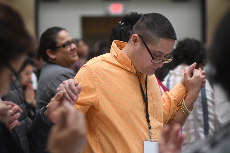 Pedro Narez from St. Gabirel Parish in Hopkins, Minn., in the Archdiocese of St. Paul and Minneapolis prays April 13 during the Region VIII encuentro at Arrowwood Resort and Conference Center in Alexandria, Minn. (CNS photo/Dianne Towalski, The Catholic Spirit)