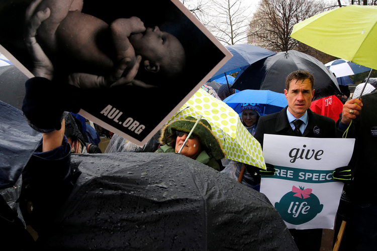 A pro-life advocate holds a sign during a March 20 rally outside the U.S. Supreme Court in Washington (CNS photo/Jonathan Ernst, Reuters).