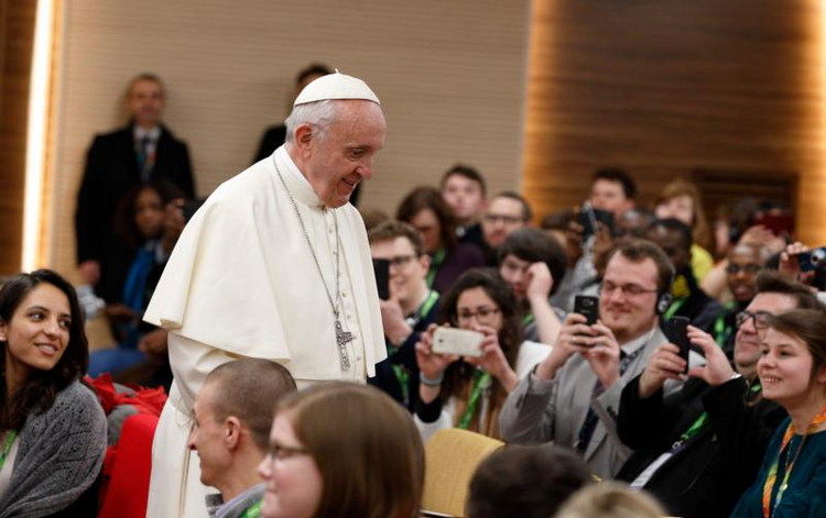 Pope Francis prepares to take a photo with young people at a presynod gathering of youth delegates in Rome March 19.  (CNS photo/Paul Haring)
