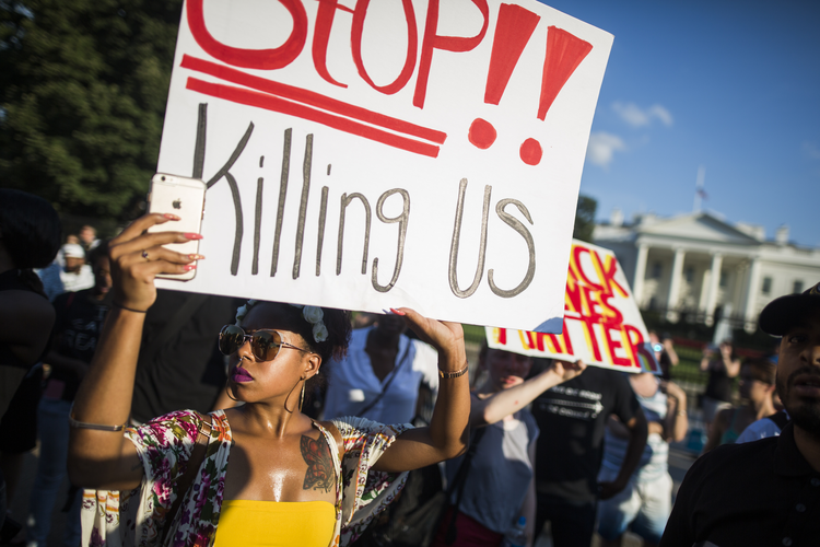 People demonstrate outside the White House in Washington on July 8, 2016 against the nationwide police shootings of African- Americans (CNS photo/Jim Lo Scalzo, EPA).