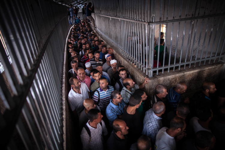 People cross into Jerusalem from the West Bank through Checkpoint 300 (CNS photo/courtesy Sean Hawkey, World Council of Churches).