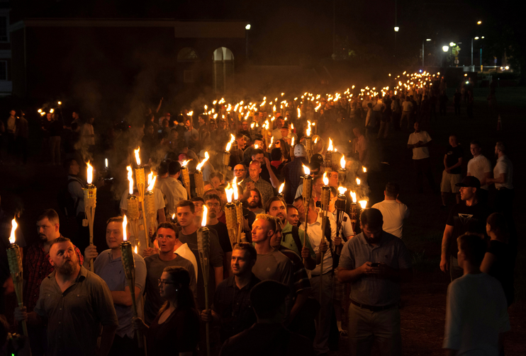 White nationalists carry torches on the grounds of the University of Virginia in Charlottesville, Va., Aug. 11 over a plan to remove the statue of a Confederate general from a city park (CNS photo/Alejandro Alvarez, News2Share via Reuters).