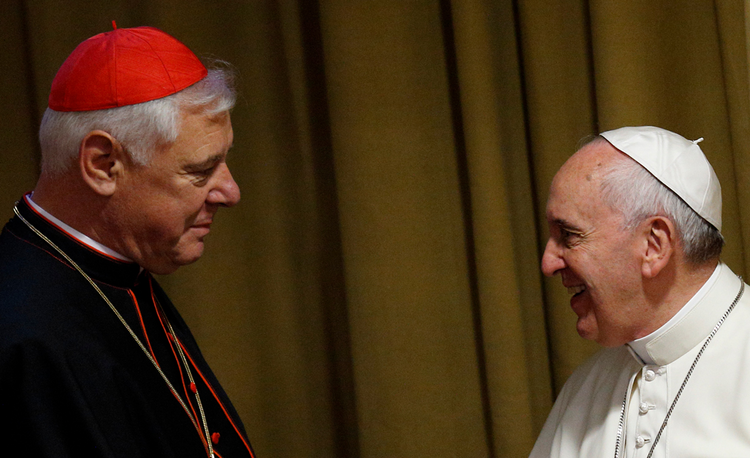 Cardinal Gerhard Müller greeting Pope Francis during the 2014 synod on the family. (CNS photo/Paul Haring)