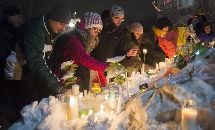 A vigil in Quebec City on Jan. 30 for victims of Sunday's deadly shooting at a Quebec City mosque. (Paul Chiasson/The Canadian Press via AP)