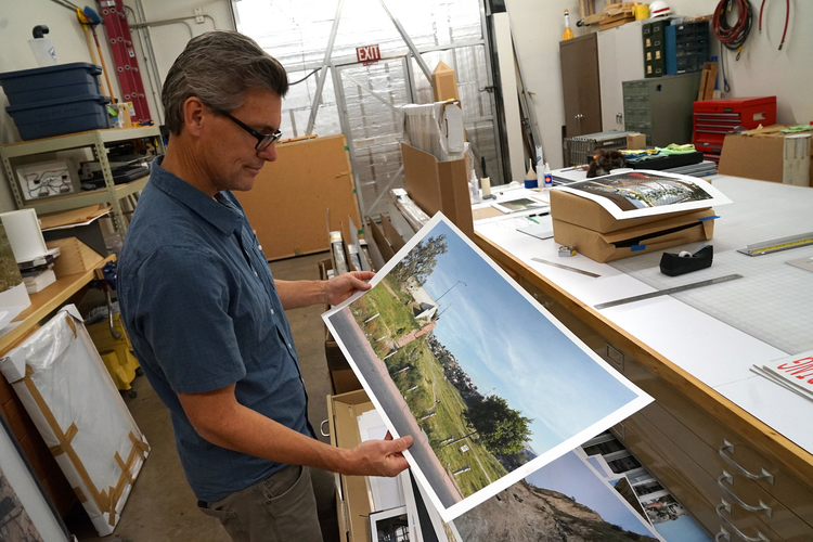 Photographer David Taylor talks about his work on the U.S.-Mexico border in studio in Tucson, Ariz. (J.D. Long-García)