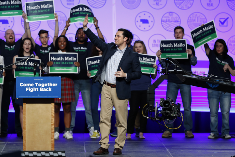 Omaha Democratic mayoral candidate Heath Mello waves to supporters at a rally on April 20.  (AP Photo/Charlie Neibergall)