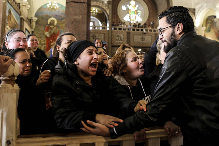 Women cry during the funeral for those killed in a Palm Sunday church attack in Alexandria Egypt, at the Mar Amina church, on Monday, April 10, 2017. (AP Photo/Samer Abdallah)