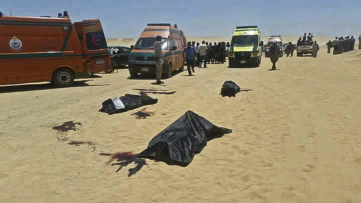 This image released by the Minya governorate media office shows bodies of victims killed when gunmen stormed a bus in Minya, Egypt, Friday, May 26, 2017 (Minya Governorate Media office via AP).