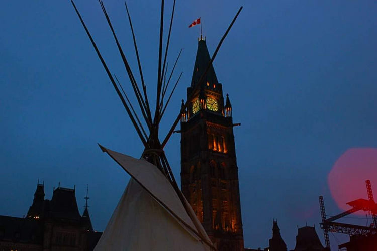 A tepee rises in protest outside Ottawa's Parliament. Photo by Ashley Courchene.