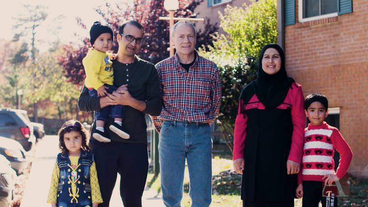 Rich McKinless with Rahim and Rayhanna Ibrahimi, and their three children, Layma, Hamza and Hasib