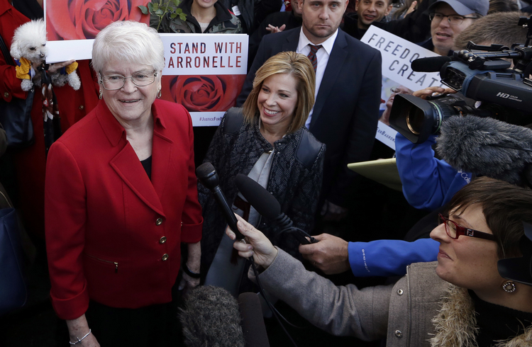 Barronelle Stutzman, left, meets with supporters outside Washington's state Supreme Court. (AP Photo/Elaine Thompson, File)