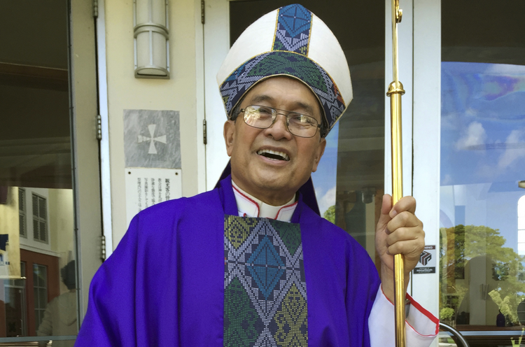 In this November, 2014 file photo, Archbishop Anthony Apuron stands in front of the Dulce Nombre de Maria Cathedral Basilica in Hagatna, Guam. (AP Photo/Grace Garces Bordallo, File)