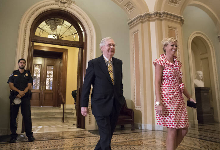 Senate Majority Leader Mitch McConnell, R-Ky. walks from the Senate Chamber on Capitol Hill in Washington, Tuesday, July 25, 2017, as he steers the Senate toward a crucial vote on the Republican health care bill. (AP Photo/J. Scott Applewhite)