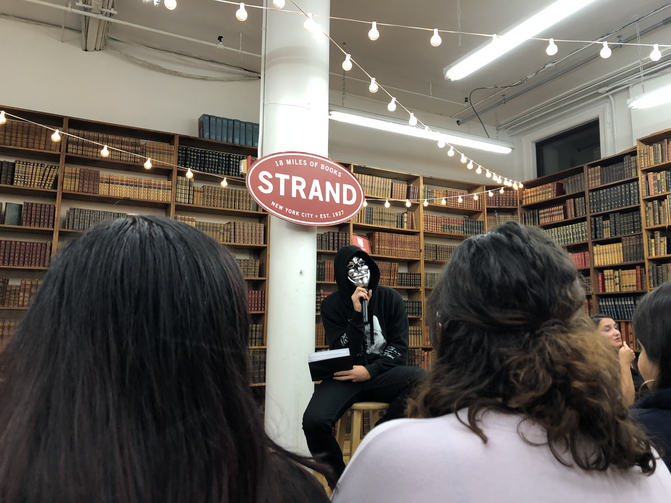 Atticus reading at The Strand bookstore in New York City.