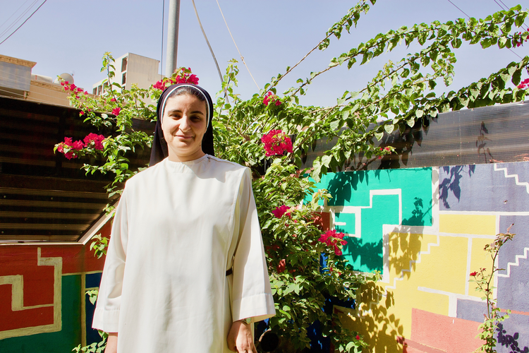 Image: Sister Nazik Matty in her garden in Erbil. Photo by Kevin Clarke.