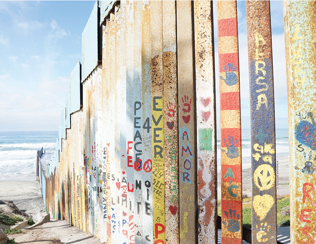 Residents of Tijuana, Baja California, Mexico, decorate the southern side of the barrier at the border with messages of peace and love. (J.D. Long-García)