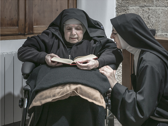 Sister Maria Giuseppina (left) and Sister Maria Caterina (right) are among 10 remaining nuns in a convent on the island of Sardinia who are breaking their silence and embracing the internet in an effort to ensure their order's survival. This photo is from an exhibition being held at the Santa Chiara convent in Sardinia. Photo courtesy of Gabriele Calvisi.