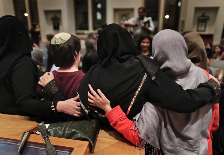 In this Thursday, Feb. 16, 2017 photo, members of the Sisterhood Salaam Shalom, gather for a group photo after a unity vigil held at the Jewish Theological Seminary in New York. (AP Photo/Julie Jacobson)