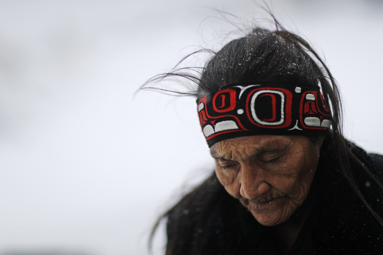 Grandma Redfeather of the Sioux Native American tribe walks in the snow to get water at the Oceti Sakowin camp in November, where people protesters gathered the Dakota Access oil pipeline in Cannon Ball, N.D. (AP Photo/David Goldman, File).
